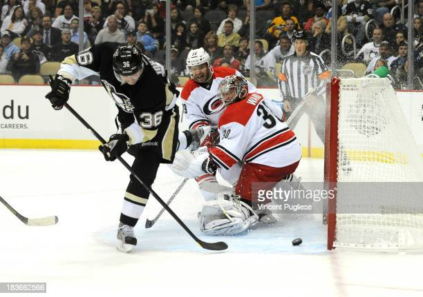 Jussi Jokinen of the Pittsburgh Penguins beats Cam Ward of the Carolina Hurricanes to give the Penguins a 1-0 lead during the first period on October...