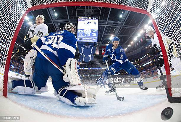Jussi Jokinen of the Pittsburgh Penguins scores during the first period of the game against the Tampa Bay Lightning at the Tampa Bay Times Forum on...