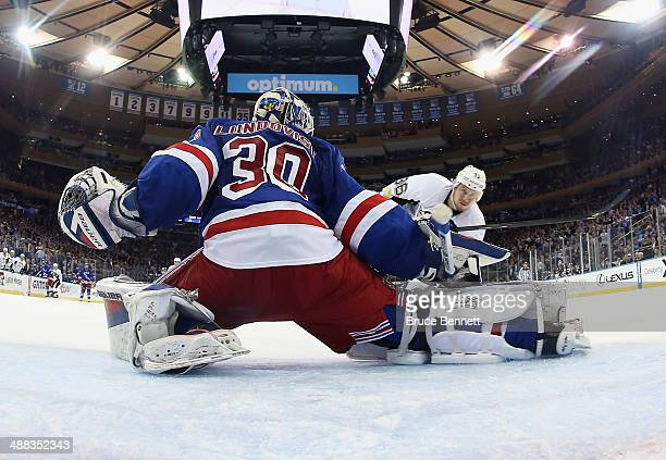 Jussi Jokinen of the Pittsburgh Penguins shoots the puck past Henrik Lundqvist of the New York Rangers for a second period goal in Game Three of the...