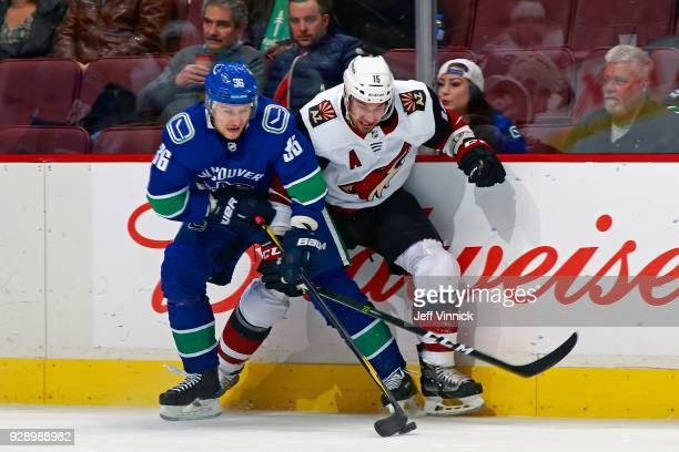 Jussi Jokinen of the Vancouver Canucks checks Brad Richardson of the Arizona Coyotes during their NHL game at Rogers Arena March 7 2018 in Vancouver...