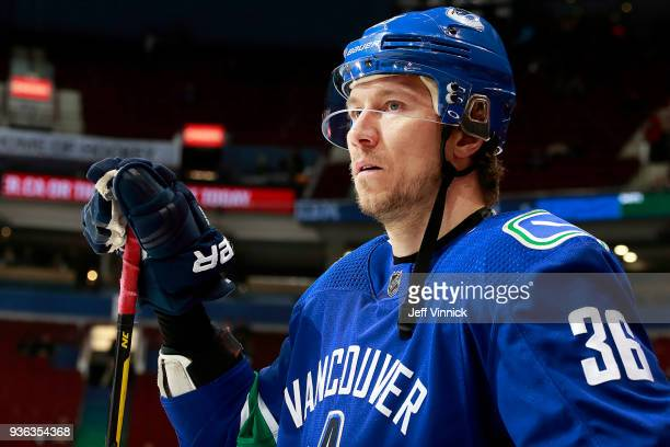 Jussi Jokinen of the Vancouver Canucks looks on from the bench during their NHL game against the Minnesota Wild at Rogers Arena March 9, 2018 in...
