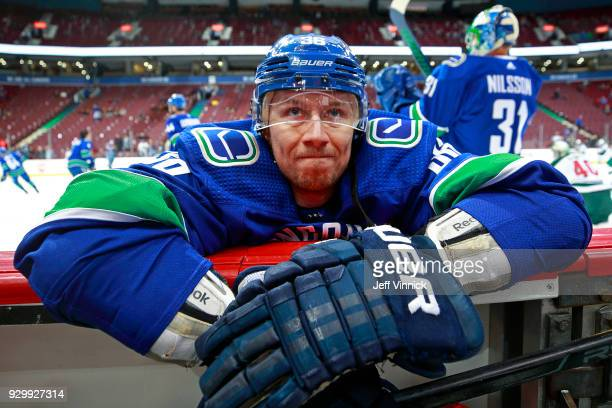 Jussi Jokinen of the Vancouver Canucks stretches during the warmup before their NHL game against the Minnesota Wild at Rogers Arena March 9, 2018 in...