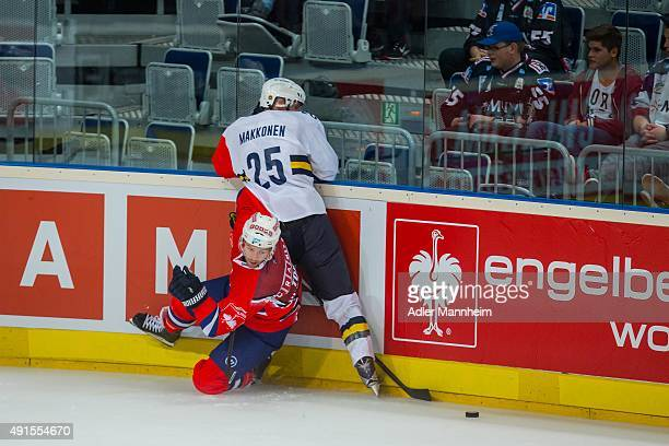 Jussi Makkonen of Espoo Blues in action with Brent Raedeke of Adler Mannheim during the Champions Hockey League round of thirty-two game between...