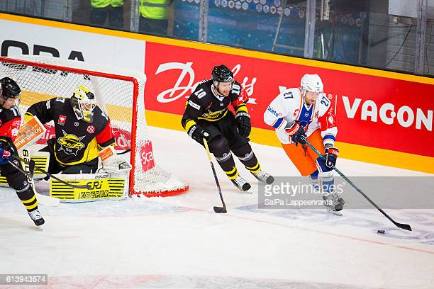Jussi Markkanen and Curtis Hamilton of Lappeenranta challenges Martin Roymark of Tampere during the Champions Hockey League Round of 32 match between...