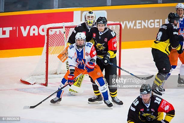 Jussi Markkanen and Tero Koskiranta of Lappeenranta challenges Jere Karjalainen of Tampere during the Champions Hockey League Round of 32 match...