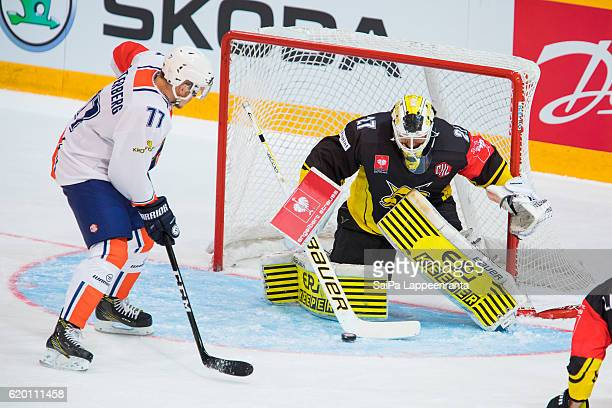 Jussi MArkkanen of Lappeenranta saves Pontus Netterberg of Vaxjo during the Champions Hockey League Round of 16 match between SaiPa Lappeenranta and...