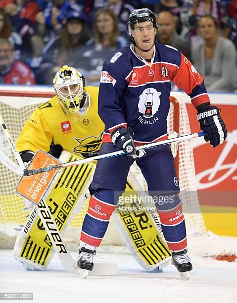 Jussi Markkanen of SaiPa Lappeenranta and Nick Petersen of the Eisbaeren Berlin during the Champions Hockey League game between the Eisbaeren Berlin...