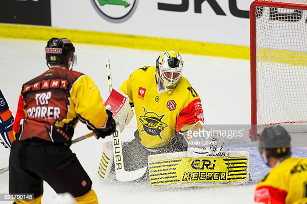 Jussi Markkanen of SaiPa Lappeenranta is making a glove save during the Champions Hockey League Round of 16 match between Vaxjo Lakers and SaiPa...