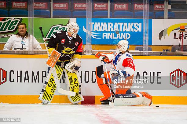 Jussi Olkinuora of Lappeenranta challenges Dominik Hrachovina of Tampere before the Champions Hockey League Round of 32 match between SaiPa...