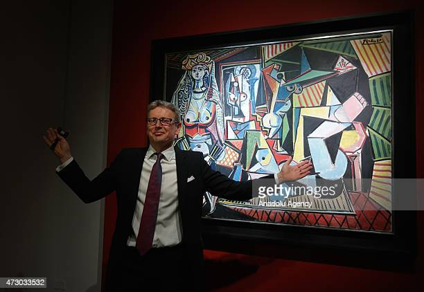Jussi Pylkkanen president of Christies stands near Picasso's painting 'Women of Algiers ' the world's most expensive painting after it fetched $1794...