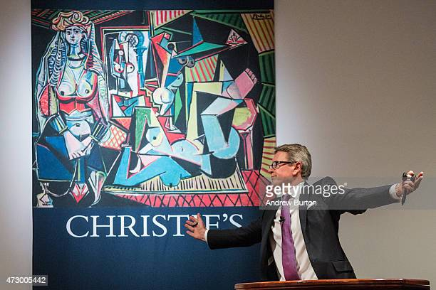 Jussi Pylkkanen president of Christie's takes bids at an auction for the art work 'Les femmes d'Alger ' painted by Pablo Picasso at Christie's on May...