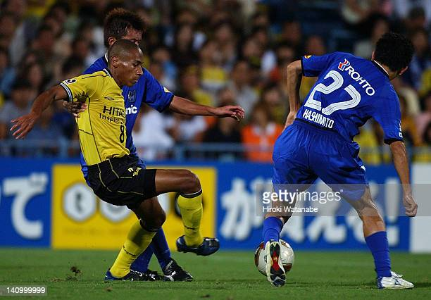 Jussie Ferreira Vieira of Kashiwa Reysol and Hideo Hashimoto of Gamba Osaka compete for the ball during the JLeague match between Kashiwa Reysol and...