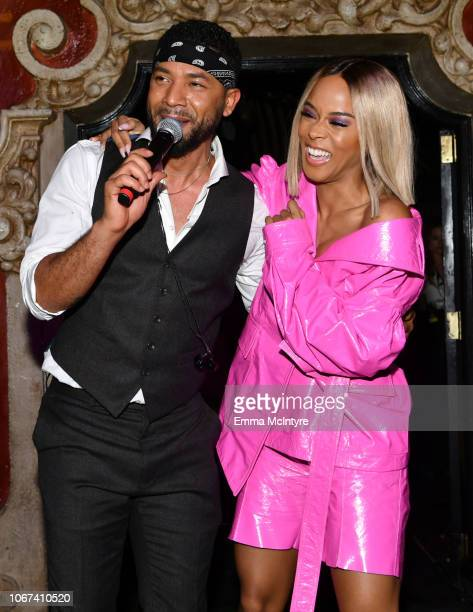 Jussie Smollett and Serayah McNeill perform onstage during amfAR Dance2Cure at Bardot on December 1, 2018 in Hollywood, California.