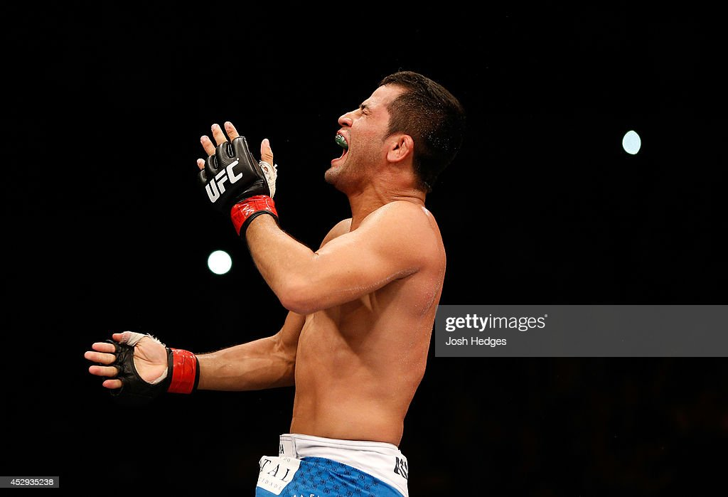 Jussier Formiga celebrates his victory over Scott Jorgensen in their flyweight bout during the UFC Fight Night event at Ginasio Nelio Dias on March 23, 2014 in Natal, Brazil.