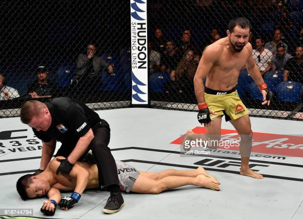 Jussier Formiga of Brazil celebrates his submission victory over Ben Nguyen in their flyweight bout during the UFC 221 event at Perth Arena on...