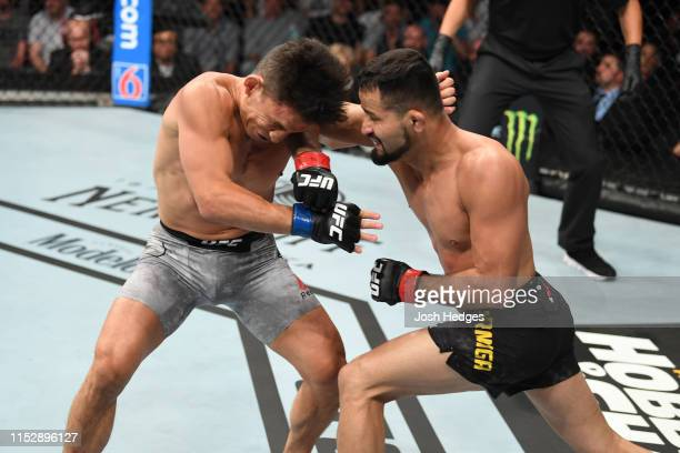 Jussier Formiga of Brazil elbows Joseph Benavidez in their flyweight bout during the UFC Fight Night event at the Target Center on June 29, 2019 in...