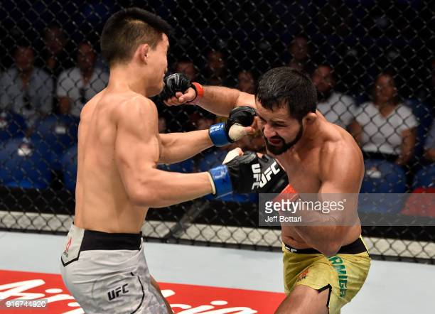 Jussier Formiga of Brazil exchanges punches with Ben Nguyen in their flyweight bout during the UFC 221 event at Perth Arena on February 11, 2018 in...