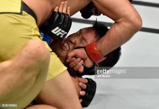 Jussier Formiga of Brazil punches Ben Nguyen in their flyweight bout during the UFC 221 event at Perth Arena on February 11, 2018 in Perth, Australia.