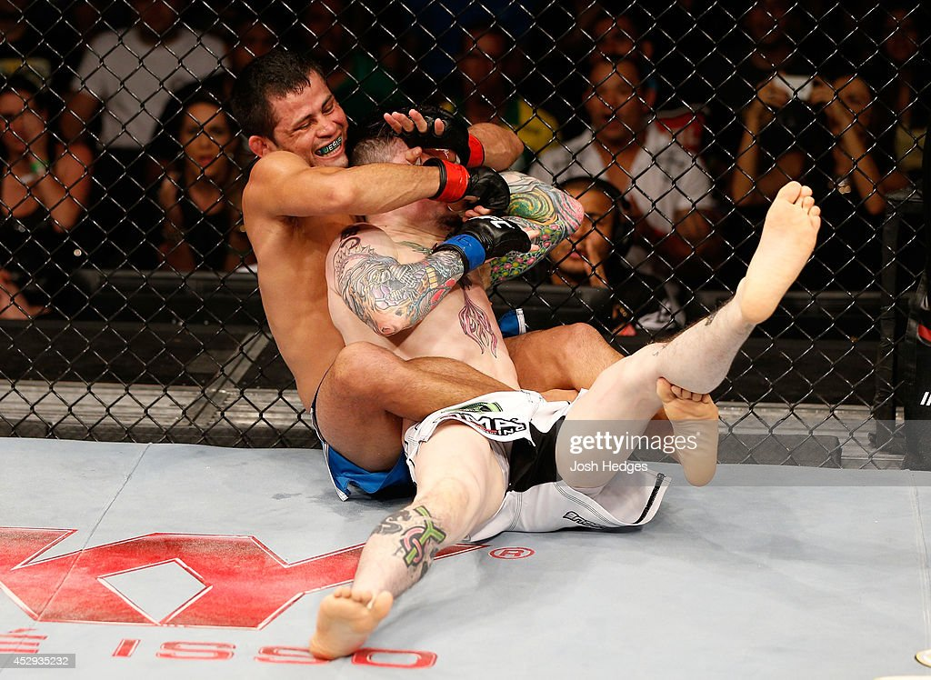 Jussier Formiga secures a rear choke submission against Scott Jorgensen in their flyweight bout during the UFC Fight Night event at Ginasio Nelio Dias on March 23, 2014 in Natal, Brazil.