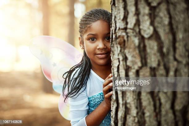 just a cute fairy fluttering around the woods - fairy stock pictures, royalty-free photos & images
