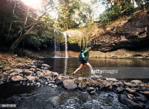 just a few more steps to the waterfall - wilderness stock photos and pictures