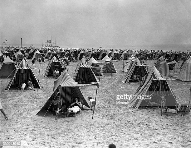 Just a few of the famous multicoloured beach tents at Le Touquet in Northern France August 1953 P012302