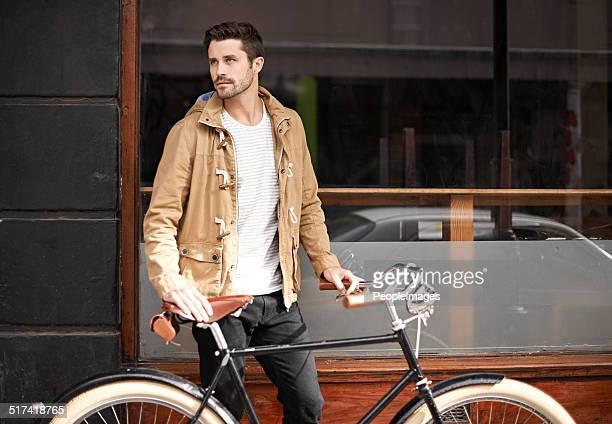 nur ein mann und seine fahrrad - coat stock-fotos und bilder
