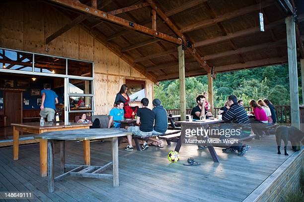 Just a short distance from Christchurch, Rangitata is a main stop for rafting down the Rangitata Gorge and the Rangitata River. This hostel and rafting center is located right next to the river. Travlers socializing on this summer afternoon