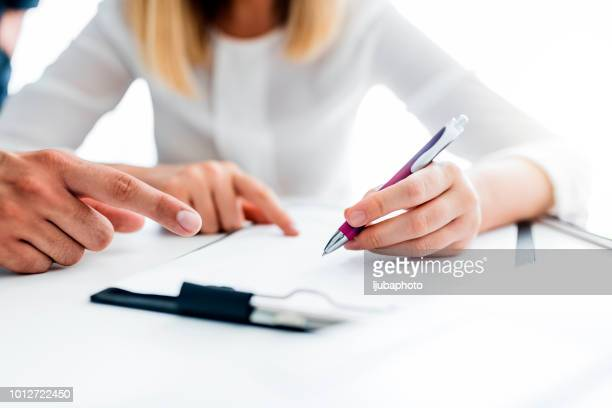 just a signature and it's all yours - health insurance stock pictures, royalty-free photos & images