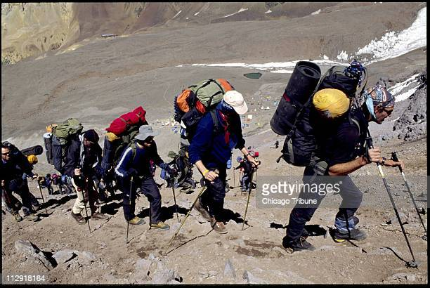 Just above base camp at Plaza de Mulas at 14000 feet climbers can dress lightly But they have to be prepared for subfreezing temperatures and breath...