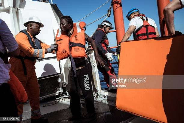 Just after having been rescued from a rubber boat in distress a woman cries while setting foot on board the Aquarius on March 3rd 2017 Pushed by...