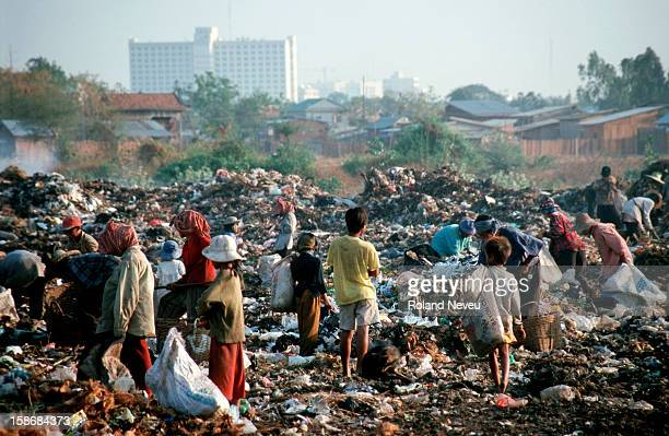 Just at the fringe of the city entire families make a living by sifting through the garbage at a dump