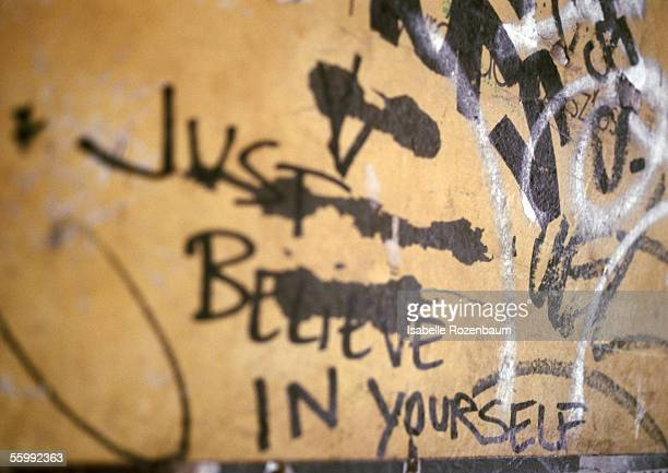 Just believe in yourself written text and graffiti on wall, close-up
