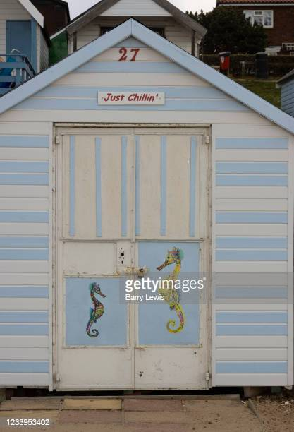 """""""Just Chillin'"""" beach hut on a small island with sandy beaches the river Blackwater on 2nd May 2021 in Mersea Island, Essex, United Kingdom. It is..."""
