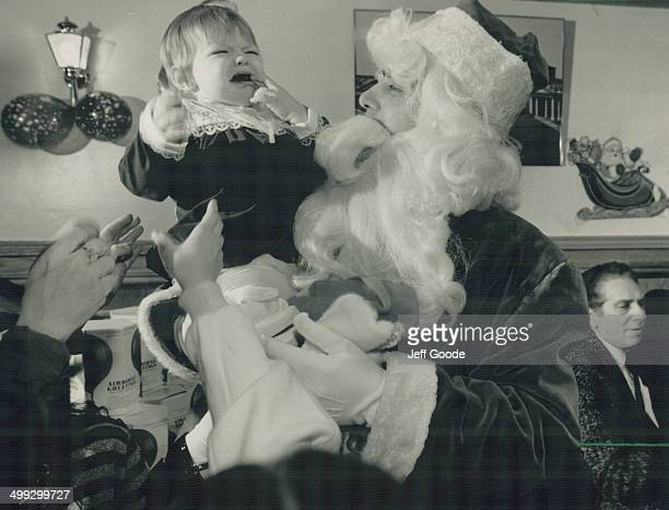 Just cut the small talk 17monthold Naomi Greeman is less than delighted to meet Santa Claus yesterday at a free Christmas party for 600 hosted by...
