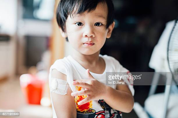 just finished his vaccination - vaccination stock pictures, royalty-free photos & images