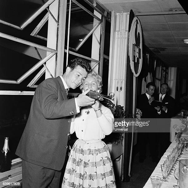 Just Fontaine shows to his wife his trophy a gun for best scorer of the 1958 FIFA World Cup Fontaine held the record for most goals scored in a...