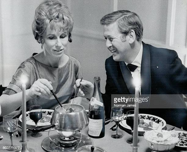 Just for fun foog might be a beef fondue Bourgignone served up hot in a chafing dish Here Henry Comor and his wife actress Jill Showell use special...