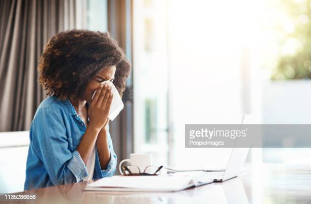 i just hate getting sick, especially at this time - blowing nose stock pictures, royalty-free photos & images
