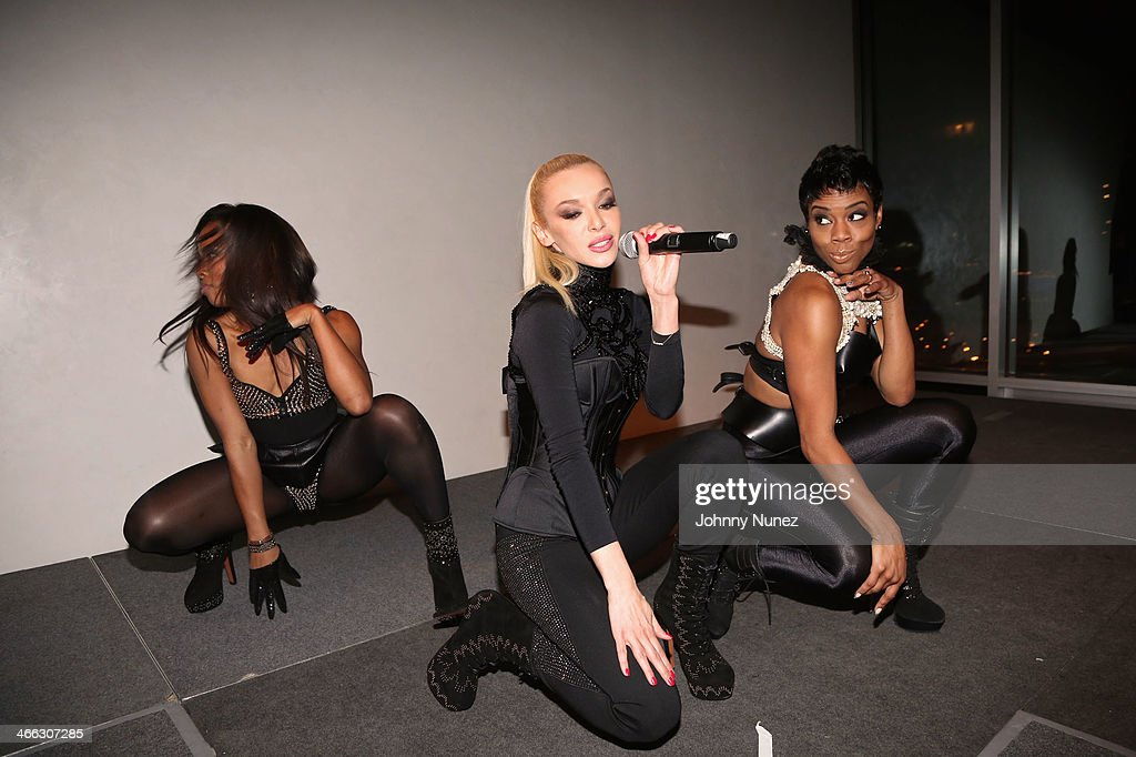 Just Ivy (c) performs with dancers Christina Webber (L) and Brandee (r) during the Just Ivy Private Showcase at The Glasshouses on January 31, 2014 in New York City.