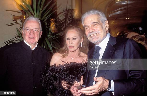 Just Jaeckin Ursula Andress and Omar Sharif during Gala Dinner for the Bests Awards at Royal Monceau Hotel in Paris France