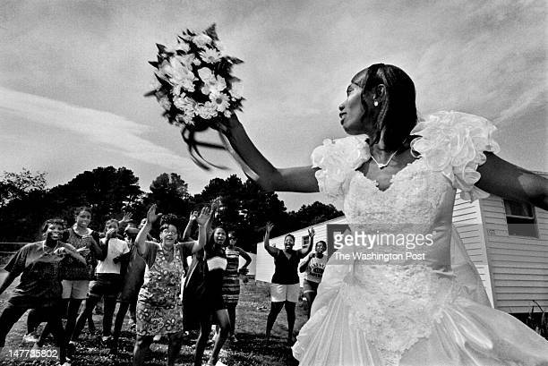 FILE Just married Brenda Bunting tosses her wedding bouquet to a crowd of eager ladies at her reception in Bayview Virginia on August 1 1998 The...