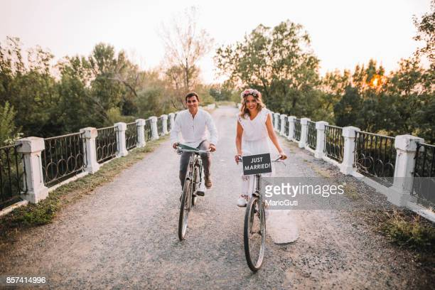 just married couple in bikes - newlywed stock pictures, royalty-free photos & images