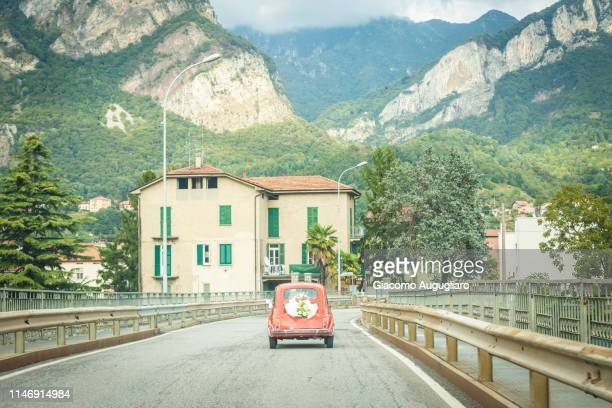 Just married couple on their wedding car. Italy