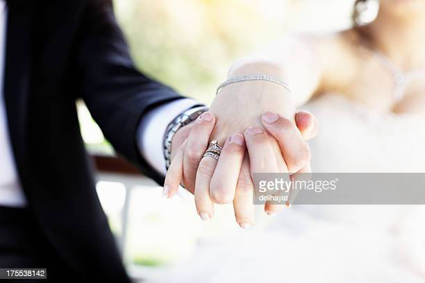 just married - man holding engagement ring stock photos and pictures
