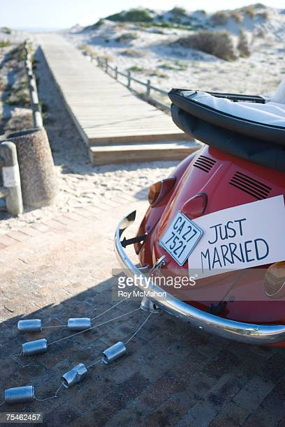 just married sign on car on beach - newlywed stock pictures, royalty-free photos & images