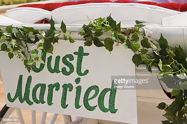 Just Married sign on carriage
