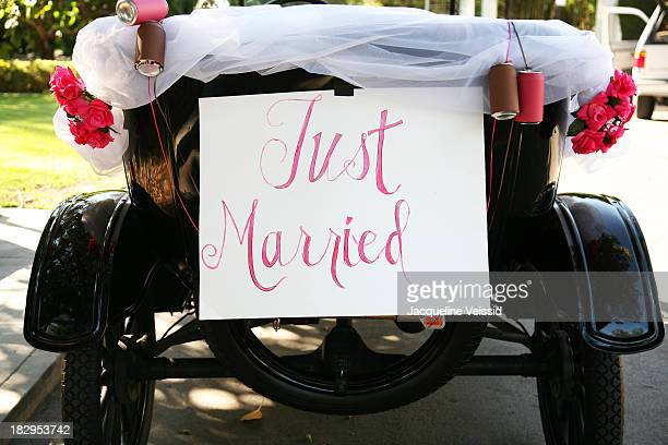 Just married sign on old fashioned car