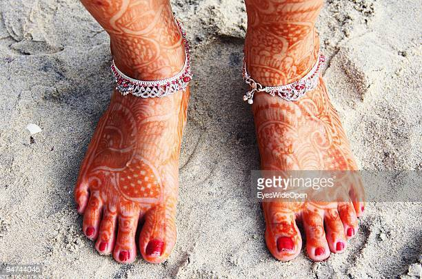 Just married woman is showing her traditional henna paintings on her feet on December 13 2009 in Kovalam Beach near Trivandrum India Arranged...