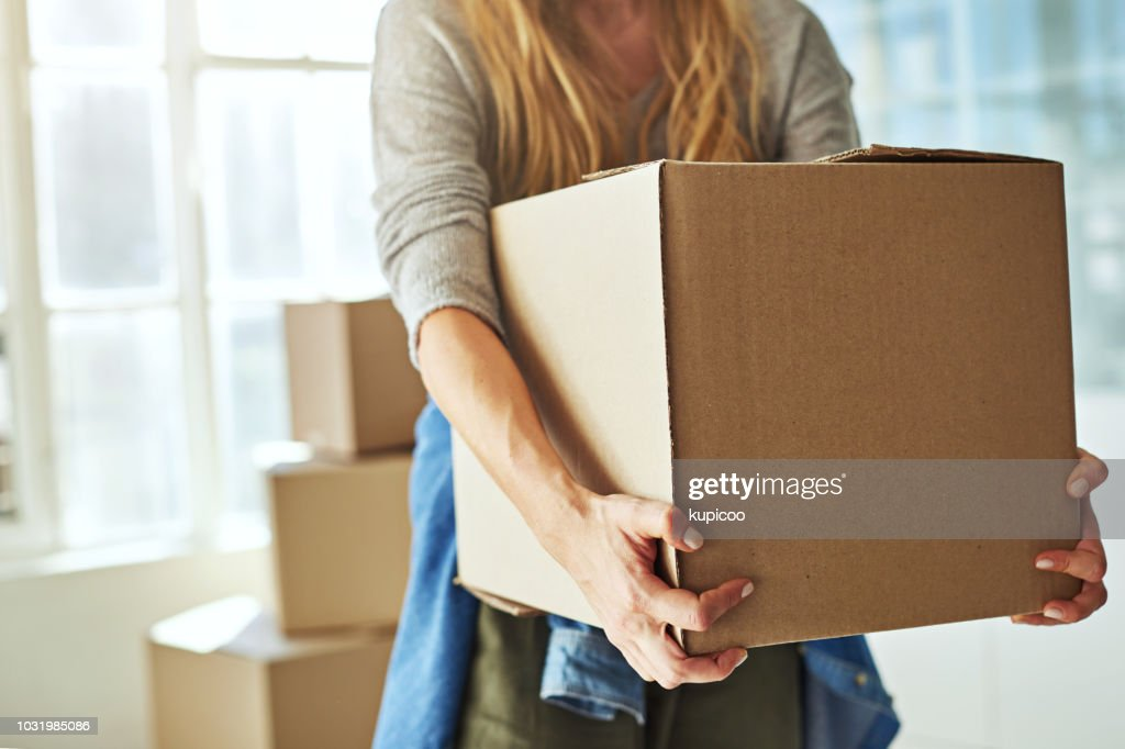 Just one more box and I'm done : Stock Photo